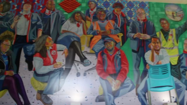 London Underground staff feature on new artwork at Brixton station ENGLAND London Brixton Brixton Station EXT Entrance to Brixton Station and artwork...