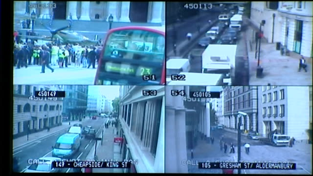 general views of cyclists traffic and people walking to work / tfl control room int close shots of monitors showing cctv footage of traffic in... - road map stock videos & royalty-free footage