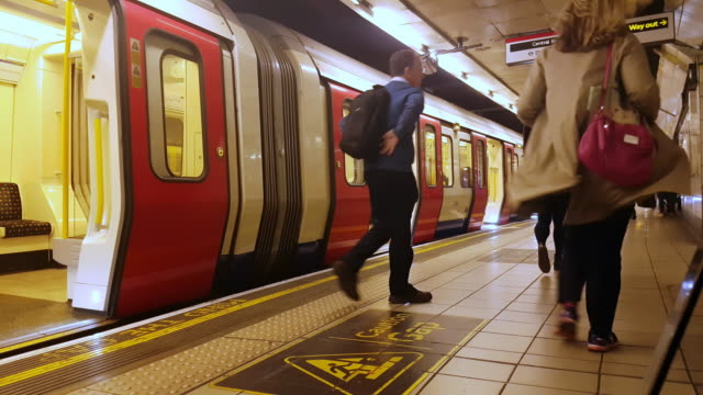 london underground train arriving at the station - tube stock videos & royalty-free footage