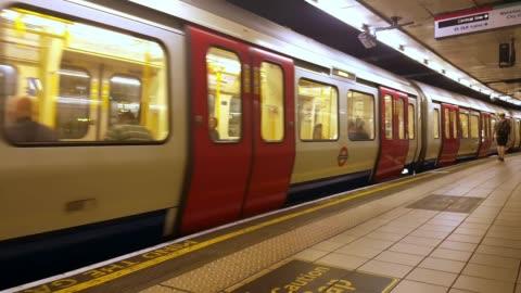 london underground train departing from the station - underground station platform stock videos & royalty-free footage