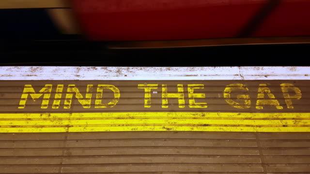 london underground train departing the station - underground station platform stock videos & royalty-free footage