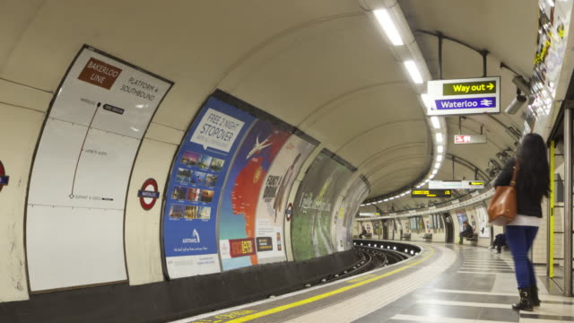 A London Underground train speeds out of Waterloo station.