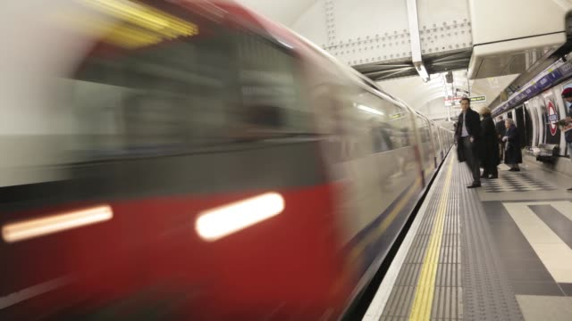 london underground train time lapse at london underground station on october 01 2012 in london england - london underground stock videos & royalty-free footage