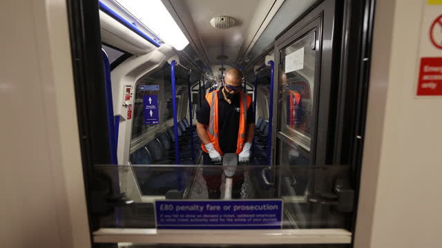 london underground trains being cleaned at alstom sa depot in morden, south london, london, uk on tuesday, june 15, 2021. - vehicle interior stock videos & royalty-free footage