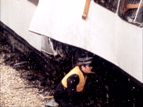 london underground tube train crash england greater london pan train with doors open police standing inside carriage pan point where two trains... - train crash stock videos and b-roll footage