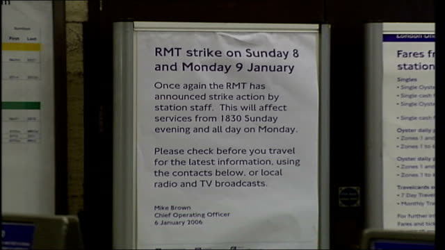 london underground workers strike england london passengers in london underground station concourse pan cms poster advising passengers of industrial... - strike industrial action stock videos & royalty-free footage