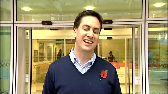 university college london hospital: ext ed miliband mp speaking to press sot - he's quite a big lad, lots of black hair, he's doing well, justine's... - big hair stock videos & royalty-free footage