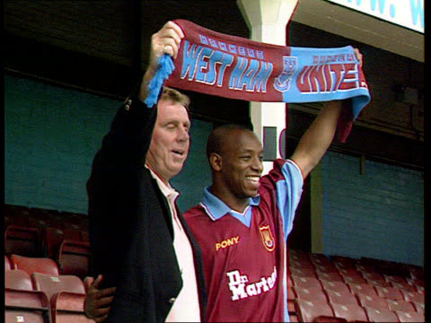 lib england london upton park ext ian wright posing with west ham united manager harry redknapp after signing for the team photographers wright - ian wright stock videos and b-roll footage