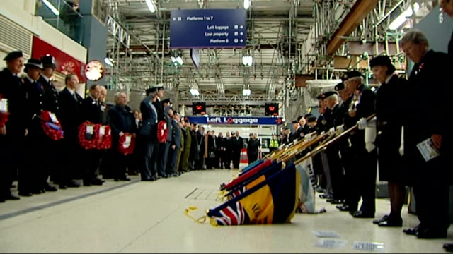 victoria station: ext last post played and veterans standing to attention inside station at service to commemorate moment 90 years ago that body of... - tomb of the unknown warrior westminster abbey stock videos & royalty-free footage