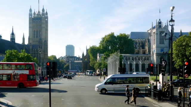 london victoria tower and westminster abbey from parliament street - westminster abbey stock videos & royalty-free footage