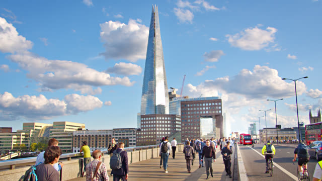 london walking bridge and the shard. pedestrians go about their day - famous place stock videos & royalty-free footage