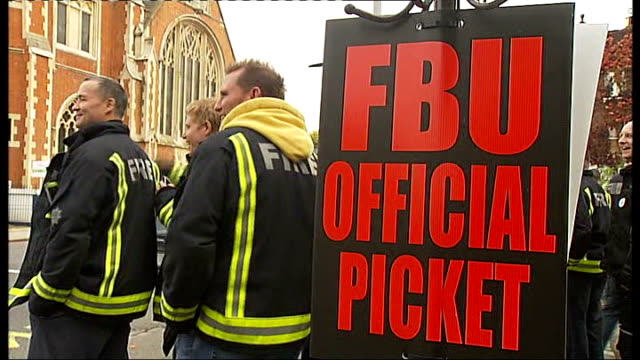 london wandsworth ext fire engines parked in car park of diy store freelance strikebreaking firefighter seated in driver's seat of fire engine three... - police line up stock videos and b-roll footage
