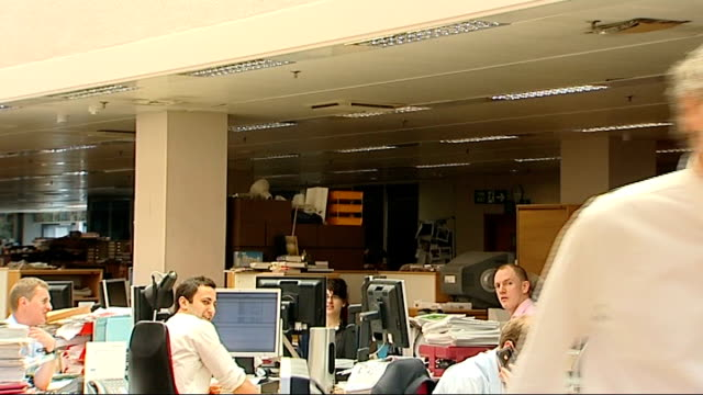 london wapping int sunday times editor john witheroe talking to journalist in newsroom rotating sign promoting news international and the times and... - calendar date stock videos & royalty-free footage