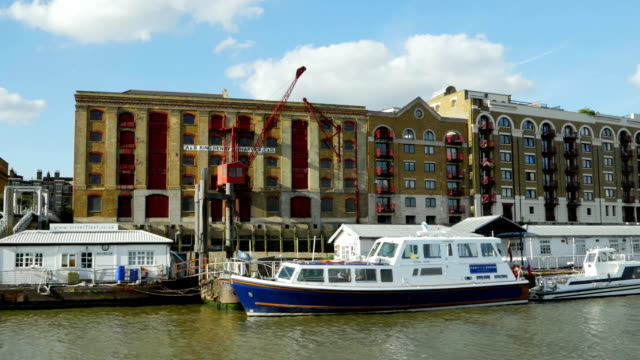 london wapping riverside boat view (4k/uhd to hd) - east london stock videos and b-roll footage