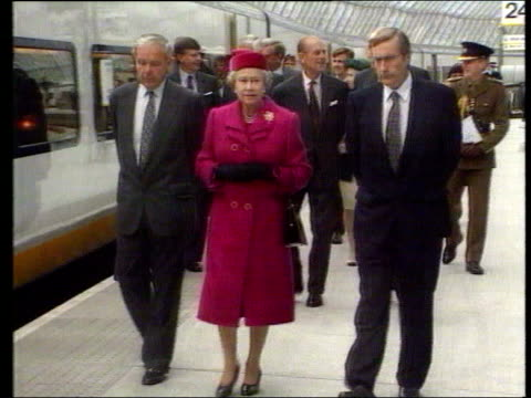 May In 1994 the Queen opens the Channel Tunnel London Waterloo Station INT/EXT Queen Elizabeth II along with Sir Bob Reid to platform to board...