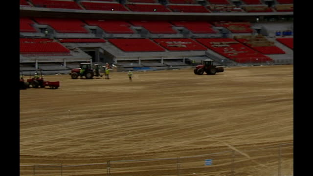 wembley stadium ext various shots workmen laying rolls of turf - turf stock videos & royalty-free footage