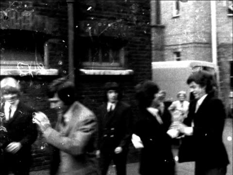 stockvideo's en b-roll-footage met england london west ham west ham court band 'the rolling stones' go to court 3 of them bill wyman mick jagger brian jones were found guilty of... - 1965