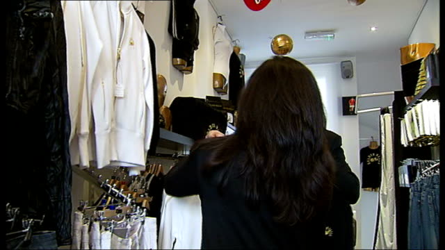 london west hampstead int gus bodur and wife inez bodur inside shop close up of golden balls price tag gus bodur and wife inez bodur interview sot - name tag stock videos and b-roll footage