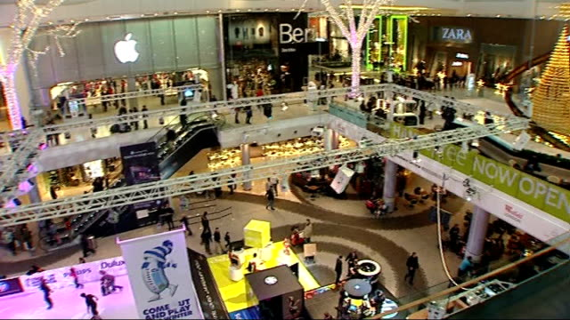 westfield shopping centre high angle views of people round on ice rink pan 'fifty percent off' sale signs on shop windows people along as '40 per... - cent sign stock videos & royalty-free footage