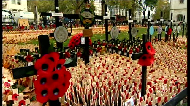 London Westminster Abbey EXT Field of Remembrance poppies in grounds of Westminster Abbey as Big Ben heard striking 11 AM SOT Big Ben clock face...