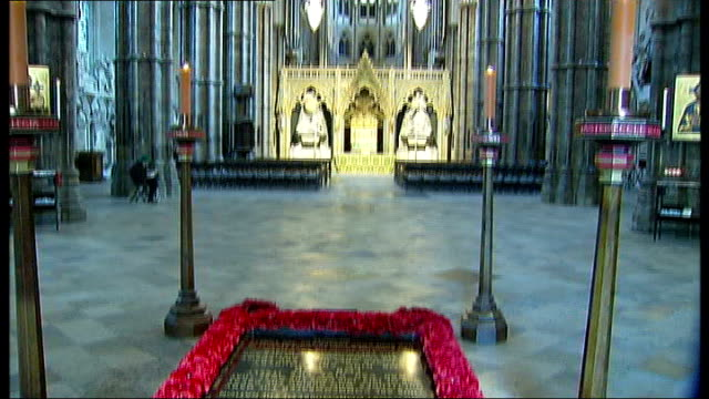 westminster abbey: int general views tombstone of the unknown warrior, surrounded by red poppy wreath - tomb of the unknown warrior westminster abbey stock videos & royalty-free footage