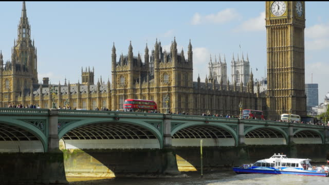 london westminster bridge and big ben (uhd) - double decker bus stock videos and b-roll footage