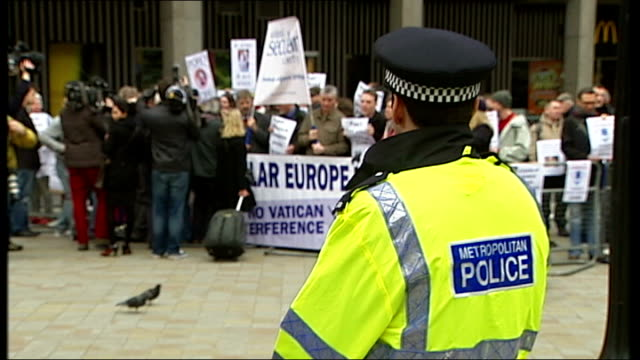 westminster cathedral: ext 'protest the pope' protestors demonstrate with placards outside westminster cathedral - westminster cathedral stock videos & royalty-free footage