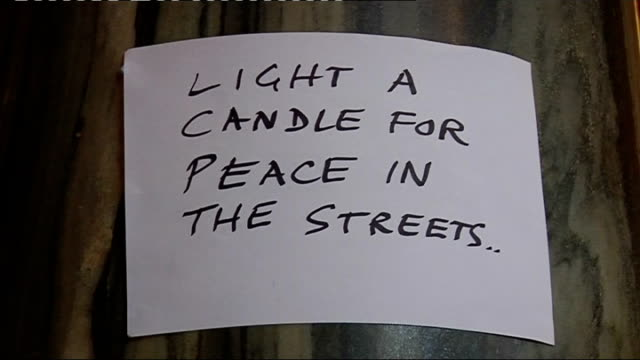 westminster cathedral: int lighted candles at prayer vigil to remember victims of gun and knife crime hand written notice 'light a candle for peace... - westminster cathedral stock videos & royalty-free footage
