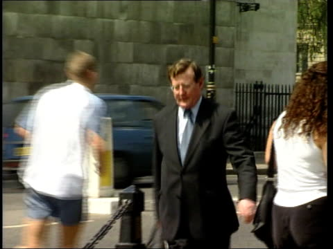 stockvideo's en b-roll-footage met london westminster ms david trimble mp towards across road and past pull bv trimble away to parliament - david trimble