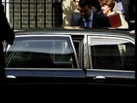 London Westminster Downing Street CMS Tony Blair towards thru door of 10 Downing Street into car PULL OUT TILT DOWN to car as man into rear seat PAN...