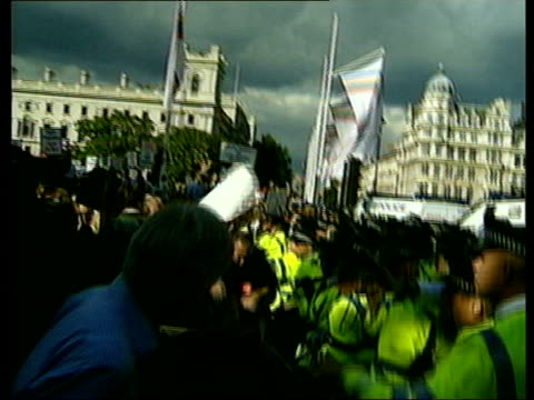 london westminster supporters of hunting clashing with police outside the palace of westminster as mps vote to ban hunting with dogs tms angry... - police line up stock videos and b-roll footage