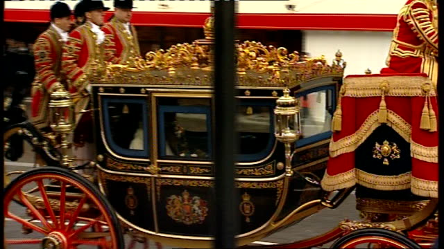 london westminster houses of parliament ext horsedrawn carriage carrying queen elizabeth ii and prince philip duke of edinburgh to state opening of... - the queen's speech state opening of uk parliament stock-videos und b-roll-filmmaterial