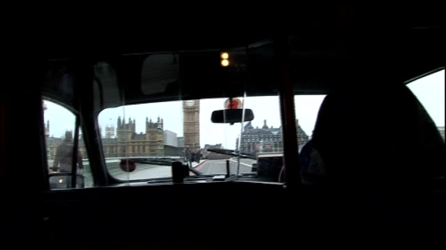 london westminster int driver point of view shot in back seat of black cab as driving through london ext black cab black taxi driven along with lit... - back seat stock videos and b-roll footage