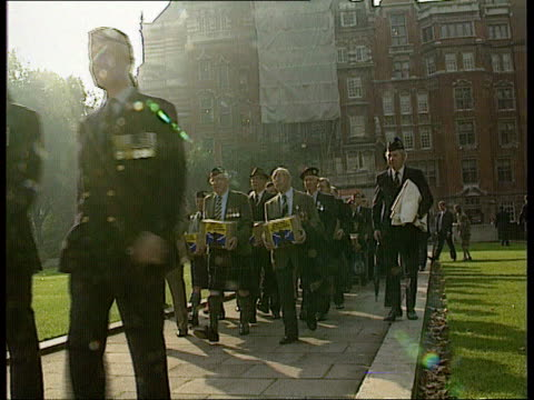 london westminster seq scots soldiers taking petition to westminster - petition stock-videos und b-roll-filmmaterial