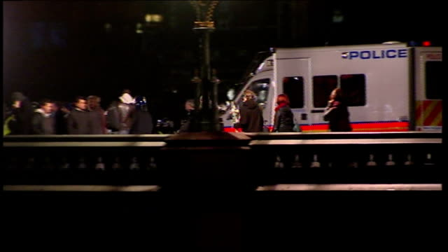 london wetsminster long shots showing group of riot police walking across westminster bridge - westminster bridge stock-videos und b-roll-filmmaterial