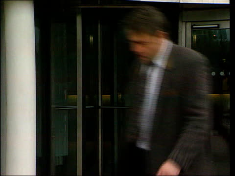 london white city broadcasting house bv man entering building gv angle view entrance pan to sign beside 'bbc television centre' - fee stock videos & royalty-free footage