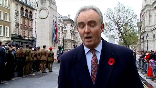 whitehall close shot of wreath and poppies laid at centoaph reporter to camera close shot of victoria cross medal on soldier's uniform members of... - リース点の映像素材/bロール