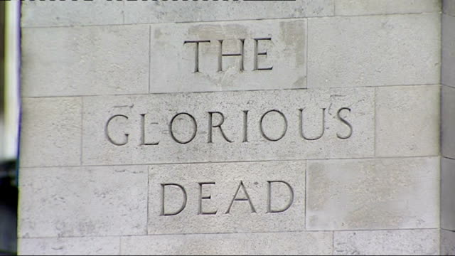whitehall: ext crowds gathered at cenotaph for armistice day ceremony 'the glorious dead' inscription on the cenotaph grenadier guards march past... - big ben点の映像素材/bロール