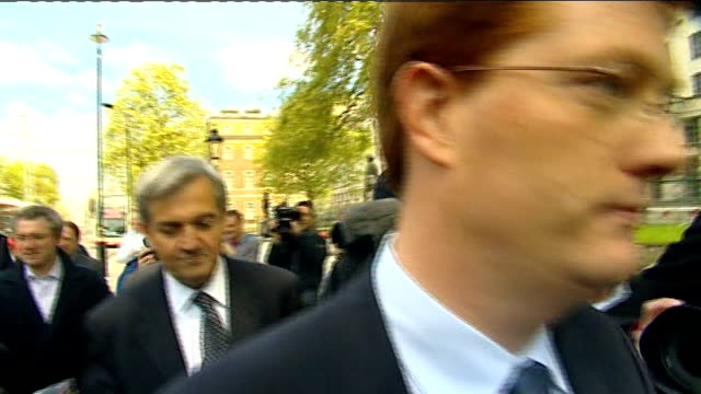 whitehall: ext liberal democrat negoatiation team - including chris huhne mp and danny alexander mp - along from meeting with conservative party... - bending over stock videos & royalty-free footage