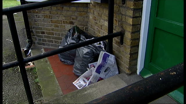 london winchmore hill ext 'the laurels' window and letter box on wall general views of front of building black bin bags and newspaper next to... - finchley stock videos and b-roll footage