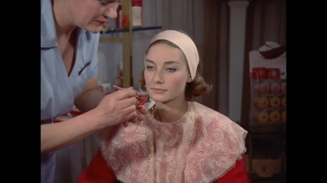 1961 - london - young women have lipstick applied in salon - beautician stock videos and b-roll footage