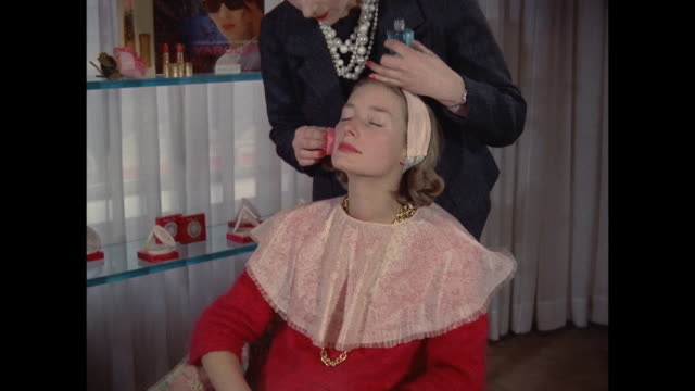 1961 - london - young women have makeup applied - beauty salon stock videos and b-roll footage