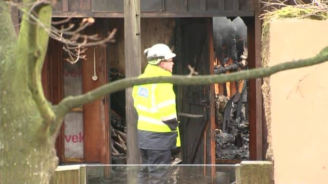 five animals feared dead zsl london zoo day firefighter inspecting smouldering roof of london zoo building gas worker along group of firefighters - five animals stock videos & royalty-free footage