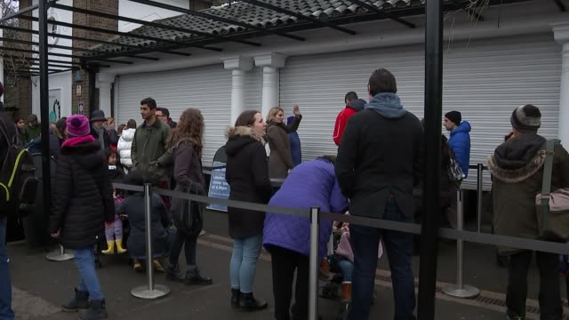 London Zoo reopens following fire which killed several animals ENGLAND London Regent's Park London Zoo EXT London Zoo entrance sign TILT DOWN people...