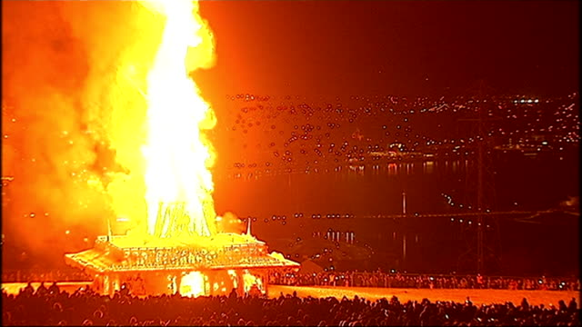 londonderry bonfire represents troubles reconciliation northern ireland londonderry various of flames rising from burning wooden tower 'temple' - derry northern ireland stock videos & royalty-free footage