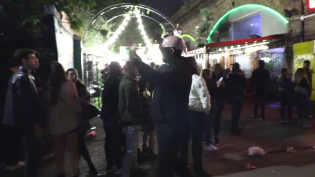 londoners enjoy an evening on the town at borhough market and in trendy shoreditch as coronavirus lockdown restrictions are eased, allowing pubs,... - nightclub stock videos & royalty-free footage