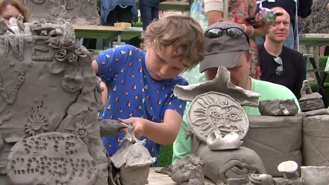 Londoners invited to create clay sculptures at Granary Square ENGLAND London Granary Square EXT Various shots people mainly children at clay...