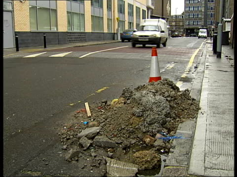 londoners view on city life bayley cycling beneath holborn viaduct i/c rubble at side of road traffic cone no entry signs at entrance to road i/c as... - sandbag stock videos and b-roll footage