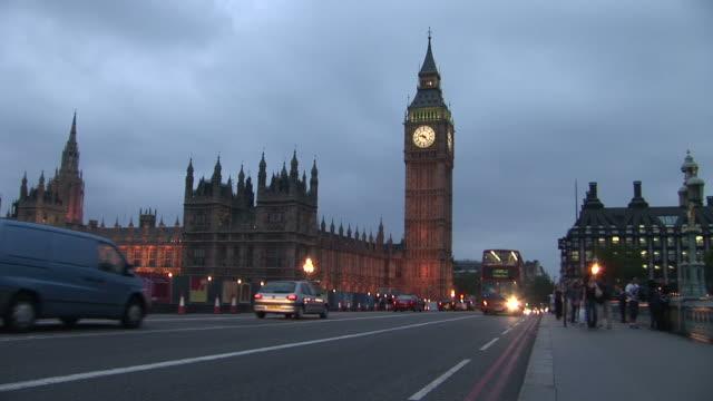 londonhouse of parliament and big ben clock tower at magic hour in london united kingdom - ウェストミンスター宮殿点の映像素材/bロール
