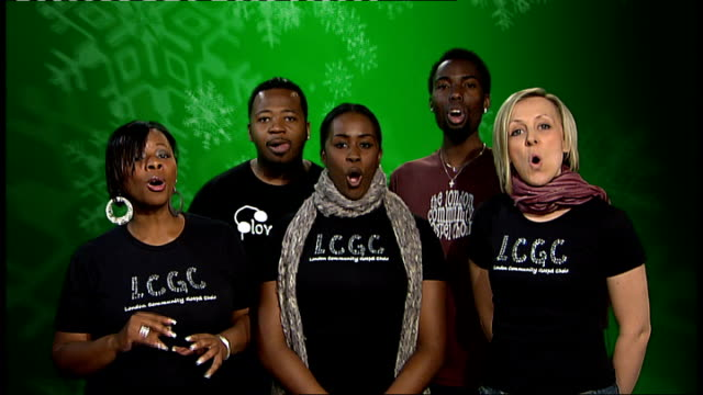 london's christmas shoppers targetted by fake charity collectors and counterfeit good traders; int london community gospel choir sing '12 days of... - ロンドン コミュニティ ゴスペル クワイア点の映像素材/bロール